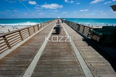 Docks on the Beach - A dock goes off into the distance in Palm Beach, Florida.