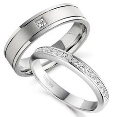 nicely designed white gold wedding rings with classic diamond arrangement