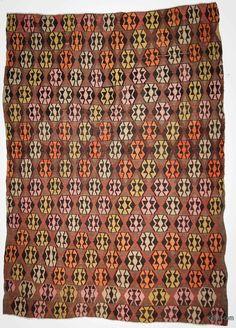 Vintage tribal kilim rug hand-woven in 1960's in Adana located in eastern Mediterranean region of Turkey.