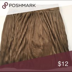 Pleated Silky Skirt  in Bronze Pleated skirt in bronze from forever 21. Super light and comfy and the length is above the knee. Lightly worn and in good condition. Size small in women. Forever 21 Skirts Mini