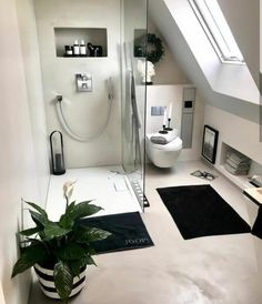 Modern Attic Bathroom Design Ideas - How to turn your attic into an extra room by creating a bathroom Install shelving in niches beneath sloping walls and create a luxurious feel with a w. Attic Shower, Small Attic Bathroom, Loft Bathroom, Upstairs Bathrooms, Bathroom Goals, Bathroom Ideas, Attic Bedroom Designs, Black White Bathrooms, Inspire Me Home Decor