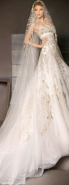 Amazing long textured gown: I love. Veil? Not so much