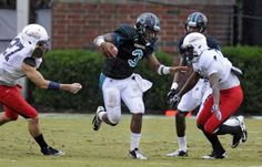 Coastal Carolina quarterback Aramia Hillary runs with the ball in the first quarter of thier game with Liberty at Brooks Stadium. Hillary was injuried in th efourth quarter and was carted off the field. Coastal won 36-12.