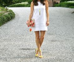 Summer party style.  White eyelet dress, embroidered clutch and neon heels.