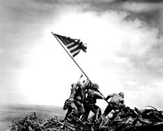 Joe Rosenthal - 1954.  Thirds.  There are many things that make this image iconic.  Subject matter obviously plays a huge part.  In most cases though, the aesthetically pleasing nature of an image contributes greatly to its place in history.  This image of the flag raising at Iwo Jima, for example, places the Marines in the lower right third of frame.  This allows the subject matter to stand out from the bright sky behind.
