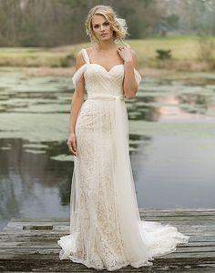 Float down the aisle in this airy tulle and lace gown with a sweetheart neckline, cold shoulder, self-tie belt at the natural waist, and cage silhouette.