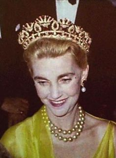 Barbara Hutton at one of her parties at Sidi Hosni, her house in Tangier, Morocco.She wears her diamond and ruby tiara and her magnificent golden pearl necklace.
