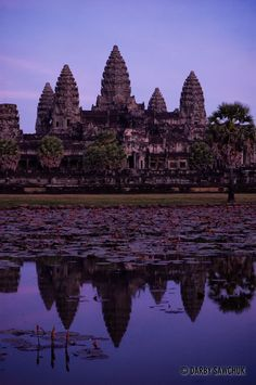 The central structure of Angkor Wat is reflected at dusk in Cambodia