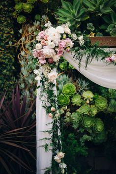 floral ceremony arch decorations - photo by The Hearts Haven http://ruffledblog.com/pastel-glam-wedding-at-las-smogshoppe #ceremonies #weddingaltar #altar