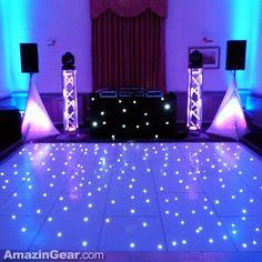 Wedding dj setup with a white led dancefloor.   #weddingdj #uplighting #mobiledj #tripodcovers #djsetup #weddingparty | SKRIMS @AmazinGear | AmazinGear.com likes this!