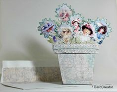1CardCreator: Blooming Beauty's   I am sharing a card I made using the Jodi Lees Natures Garden papers for the flower pot along with the Gecko Galz In my Easter Bonnet ladies.