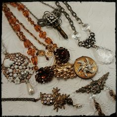 Collection of vintage upcycle assemblage necklaces available from HeldHigh Designs
