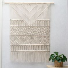 ● D E S C R I P T I O N  This gorgeous handmade macrame wall hanging is made with neutral cotton macrame cord. With this macrame wall hanging youll instantly add a bohemian vibe to your room an it will really warm up a space. ● D I M E N S I O N S This macrame wall hanging measures about:  Wooden dowel length - 80cm - 31.5 inches Macrame height- 102cm - 41 inches  ● S H I P P I N G  This item is made to order. It takes 10-14 days to make this beautiful wall hanging for you.  => Lookin...