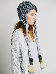 Nolita Pom Pom Beanie | Hand-spun and hand-knitted in New York City, this beanie features long strings with pompom detailing.     *By Mischa Lampert