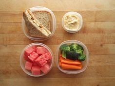 peanut butter and banana sandwich on sprouted grain bread, watermelon cubes, and broccoli and carrots with roasted garlic hummus