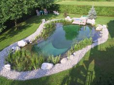 Natural swimming pond with lush plantings - schwimmteich - pool Natural Swimming Ponds, Natural Pond, Swimming Pool Designs, Swimming Pools, Lap Pools, Indoor Pools, Dream Pools, Garden Types, Ponds Backyard