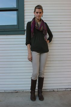 Brown riding boots, tan skinny jeans, hunter green blouse and colored scarf.