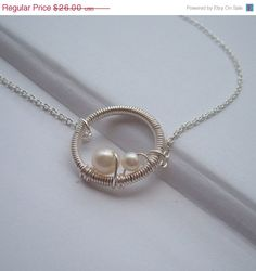 ON SALE Wire Wrapped Circle Necklace-Mommy and Me-  mother and baby pearl- Sterling Silver chain Mom to Be. $22.10, via Etsy.