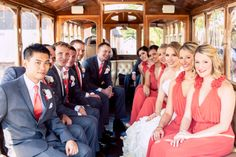 The happy wedding party on the trolley. ::Megan + Mark's bright + delightful wedding at the First Presbyterian Church and Summerour Studio in Atlanta, Georgia:: #wedding #transportation #weddingparty #bridalparty #groomsmen #bridesmaids #photographer