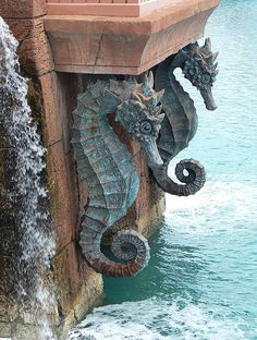 Beautiful seahorse statues form an intricate part of the architecture of Atlantis on Paradise Island, Bahamas. Paradise Island, Beach Cottages, Coastal Decor, Coastal Curtains, Coastal Bedding, Modern Coastal, Sea Creatures, Statues, Sea Shells