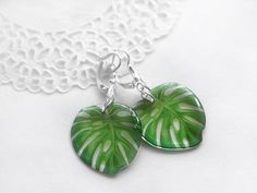 Monstera earrings Tropical plant jewelry Jungle monstera leaf earrings Botanical earrings Nature inspired Monstera Green leaves jewelry gift These Monstera leaf earrings are cute and very light. Convex on both sides, and like candy! Monstera earrings are especially beautiful in the