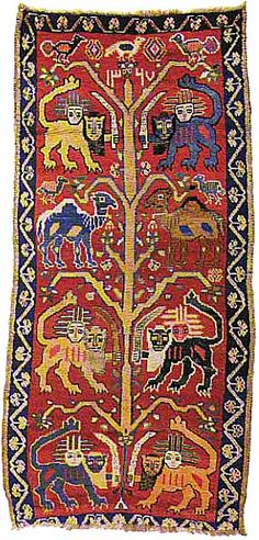 Qashqa'i, dated 1327 A.H./1909 (210 x 98 cm) The tree of life is an ancient motif of Iranian art with a history stretching back to prehistorical times. It was especially popular with the Sasanids and may be seen on many of their articles and fabrics. The placement of a lion beneath the Tree of Life is also fairly often encountered in Sasanid art. In this rug a lion or camel is placed in the shade of each branch.