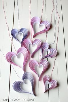 HOW TO MAKE PAPER HEARTS | These easy and fun to make paper craft can be hung for decorations, added to gifts and much more! #papercraft #paperheart #valentinesdaycraft #valentinecraft