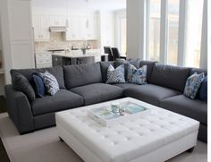 Loving this couch! But white ottoman would get filthy!