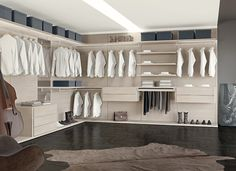 """closet wall system that turns a """"closet"""" into a fully integrated room of your house.  The Multiplo walk-in closet is a customizable collection of wall elements in a textured, bright white or natural eco-friendly wood finish that brightens up the closet space with a snap."""
