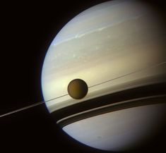 In the Shadow of Saturn's Rings - Cassini spacecraft photo of Titan, Saturn's largest moon.