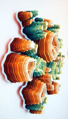 The colorful creations of American artistCharles Clary, who uses superpositions ofhand cut paper shapes and acrylic paint to imagine some beautiful and fasc