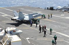 PACIFIC OCEAN (April 8, 2013) Sailors aboard the aircraft carrier USS Nimitz (CVN 68) perform a push-back on an aircraft on the flight deck . Nimitz is currently underway conducting a Sustainment Training Exercise in preparation for a scheduled deployment. (U.S. Navy Photo by Mass Communication Specialist Seaman Kole E. Carpenter/Released)