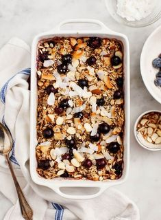 This healthy baked oatmeal is one of our go-to weekend brunch recipes and it's perfect for any celebration. Loaded with fresh fruit coconut flakes almonds hemp seeds & cinnamon it's nutty lightly sweet & nutritious. Vegan and gluten-free. Vegan Baked Oatmeal, Healthy Oatmeal Recipes, Vegan Recipes, Coconut Oatmeal, Oats Recipes, Banana Coconut, Fruit Recipes, Amish Recipes, Dutch Recipes