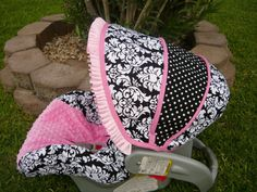 carseat cover, girly girl.   May have to have my grandma do this for me!