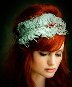This headband is gorgeous with her hair color.