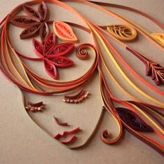 The colors of autumn inspire people all over the world to create masterpieces with thin strips of paper.