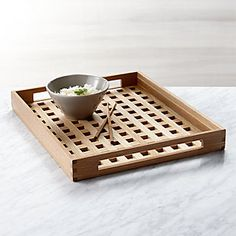 With its many cutouts creating a pleasing grid, this oak serving tray has modern summer style, and its clean pattern enhances the natural beauty of the wood. Serving Tray Wood, Wood Tray, Wood Boxes, Wooden Chopping Boards, Sr1, Small Wood Projects, Glass Centerpieces, Appetizer Plates, Pallet Furniture
