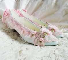 Marie Antoinette Style pumps in seafoam green and pale pink size 7. $60.00, via Etsy.