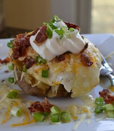 Baked potatoes topped with eggs over easy, bacon, cheddar cheese, sour cream and green onions!  Hearty and tantalizing for your taste buds!