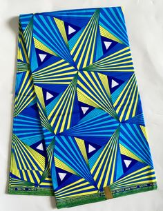 A personal favorite from my Etsy shop https://www.etsy.com/listing/520369240/african-print-fabric-ankara-blue-yellow