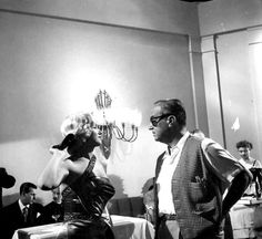 Marilyn Monroe and director Jean Negulesco on the set of How to Marry a Millionaire, 1953.