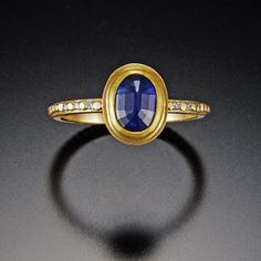Oval Blue Sapphire Ring with Raised Diamond Band | Ananda Khalsa Jewelry