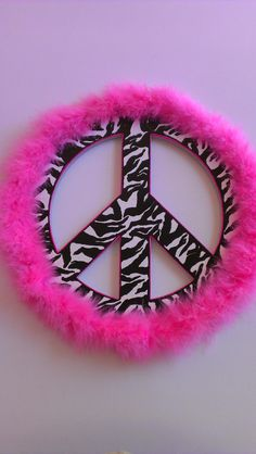Peace sign Wood peace sign from hobby lobby, spray painted and then used a paint pen to hand draw zebra stripes and pink outline. Then hot glued the pink boa.