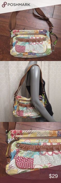 Fossil Multicolored Canvas Abstract Shoulder Bag Canvas with leather trim Zipper main closure Floral & geometric prints Adjustable nylon strap Silver hardware  3 exterior pockets, 1 zips 3 interior pockets, 1 zips Key fob Minor discoloration to bottom corners Fossil Bags Shoulder Bags