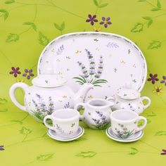 """Invite your dolls to the tea party too with a tea set that's just their size. This 10-piece miniature tea set is perfect for our 15"""" doll collection and a great size for little girl's hands. Porcelain"""