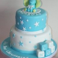 two tier christening cake with baby elephant