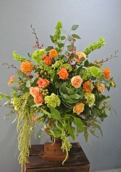 Our take on a garden inspired fall wedding alter arrangement. #gardendistrictflowers #gardeninspired #fallweddings #dahlias #fallflorals #weddingflowers #romanticweddings #weddings #flowers #eventflowers