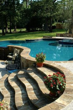 Love how the pool transitions to lower patio