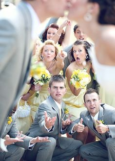 cute pose of bridal party in background of kiss