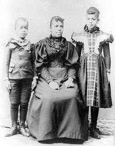 African American mother with son and daughter. For more on the African American experience and achievements in the U.S. and elsewhere visit Discover Black Heritage , a travel guide to African American history and culture.